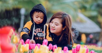 supermom with son near flowers