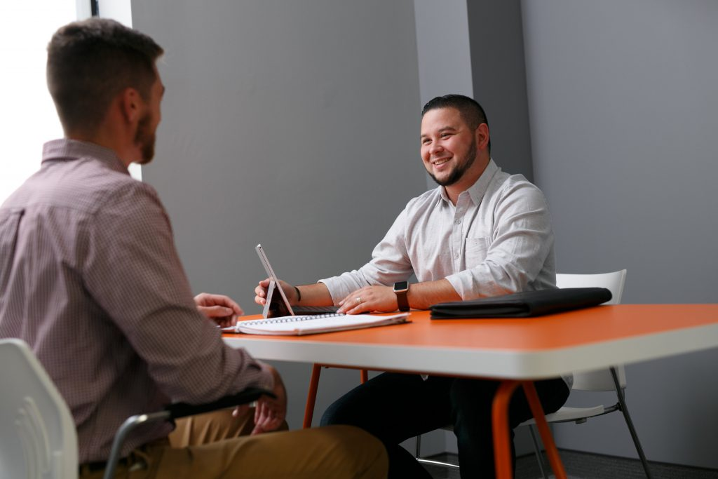 man working in the office with good posture / sitting uptight
